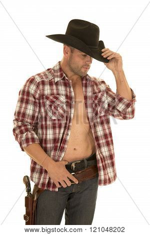 A cowboy in his plaid shirt open and showing off his chest with his pistol on his hip.