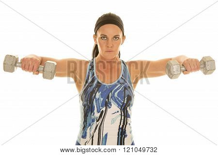 a woman working out and lifting weights to make her body healthier.
