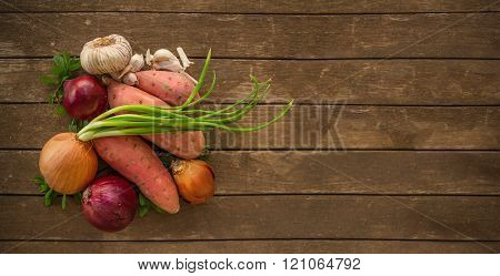 Pile of healthy vegetables on wood board