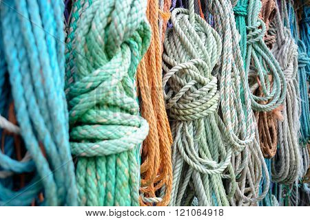Nautical Background. Closeup Of Old Colorful Mooring Ropes , Old Buoys And Fishing Gear
