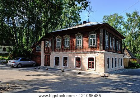 Old stone house with carved windows in Ples, Russia