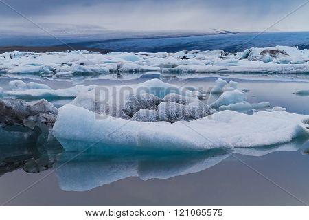 Luminous Blue Icebergs Floating In Jökulsárlón Glacial Lagoon, Iceland
