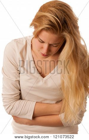 Sick woman with pain in the stomac or belly isolated over white background.
