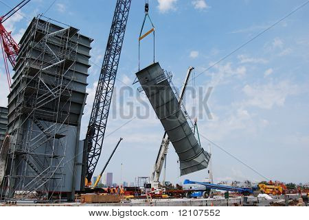 3 of 4-Industrial construction site-crane lifting smoke stack