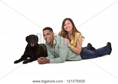 Couple with their black dog
