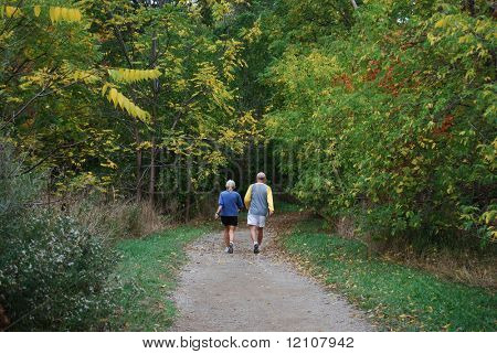 older couple strolling in park