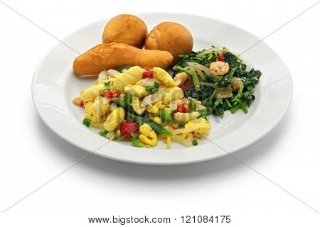 ackee and saltfish, jamaican cuisine isolated on white background