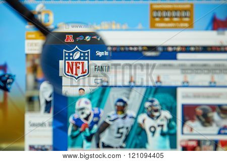 MONTREAL CANADA - MARCH 8 2016 - NFL official site and logo under magnifying glass. The National Football League is a professional American football league that constitutes one of the four major professional sports leagues in the USA.