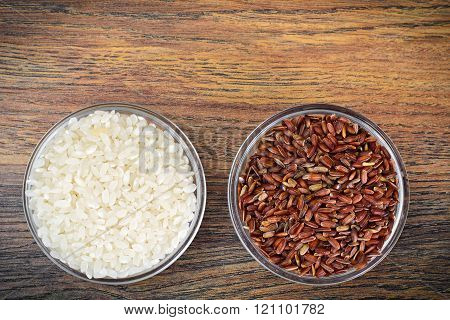 White and Red Rice in Glass Cup on Wooden Background