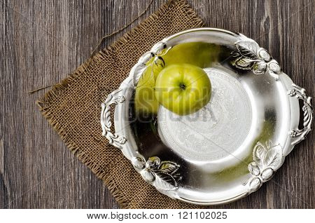green apple on vintage plate
