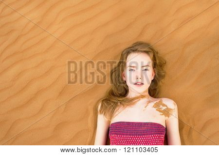 beautiful young girl in desert in Dubai