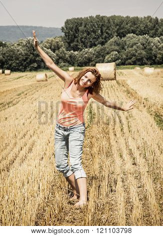 Young Crazy Woman Imitates Flying Airplane At The Field