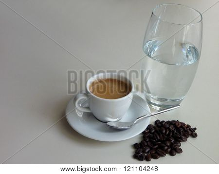 Cup Of Fresh Tasty Coffee With Coffee Beans And A Glass Of Water