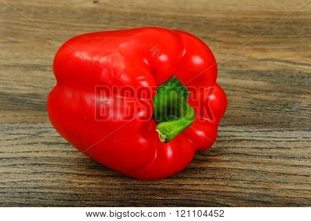 Fresh Red Bell Pepper on Wood Background.