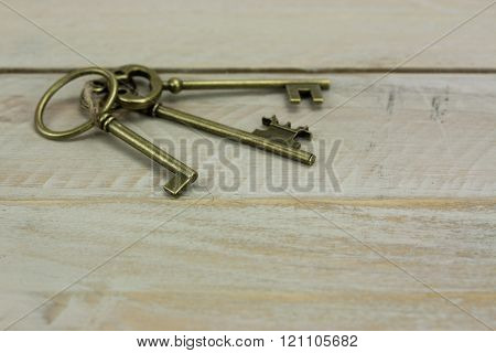 Old Keys On A Rustic Background
