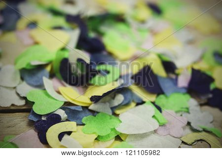 Confetti On A Wooden Background