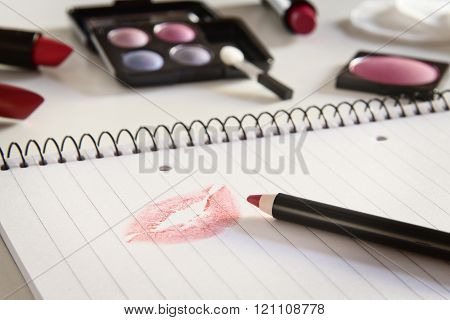 notebook with kiss and makeup