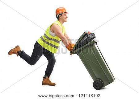 Excited young waste collector pushing a trash can and running isolated on white background