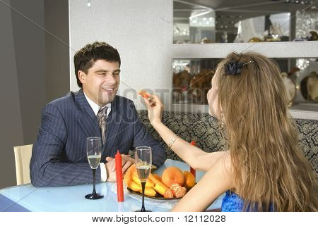 a pair of happy lovers at modern restaurant poster
