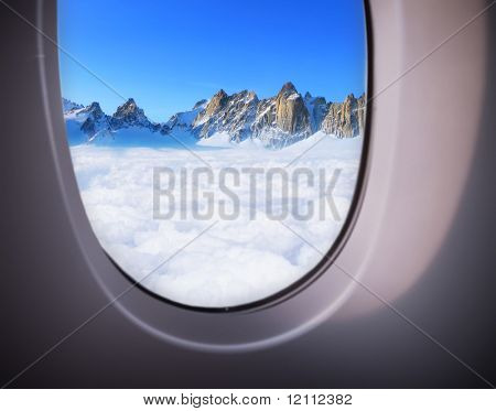 beautiful sea view from the window of plane poster