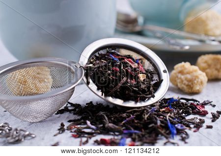 Dry black tea with flower petals. Selective focus. poster