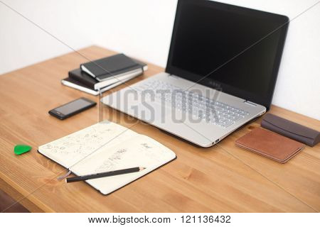 Office Workplace With Laptop, Smart Phone And Notebook On Wood Table