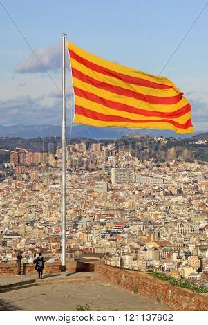 Barcelona, Catalonia, Spain - December 14, 2011: Catalan Flag Fluttering In The Wind In Montjuic Cas