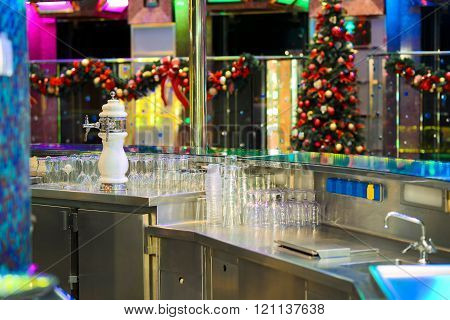 Bar which awaits its customers with Christmas decorations in background