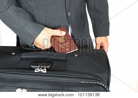 Businessman holding the passport of Thailand.