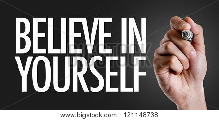 Hand writing the text: Believe in Yourself poster