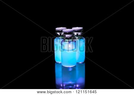 Vials With Neon Glowing Medicine