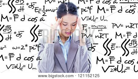 Portrait of a beautiful businesswoman having a headache against maths equation