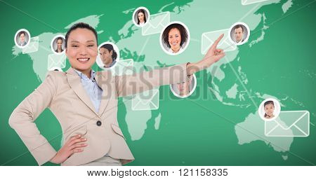 Smiling asian businesswoman pointing against map with emails