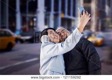 Cute couple taking selfie against blurry new york street