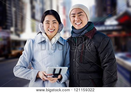 Cheerful couple against buildings against blurry new york street