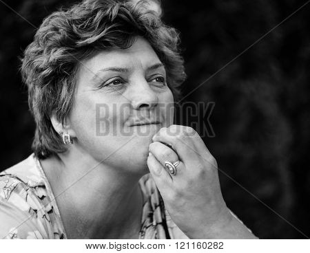 Middle-aged Woman Posing On A Black Background