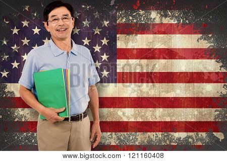Portrait of happy businessman with files against usa flag in grunge effect