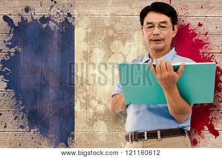Elderly man holding a green folder against france flag in grunge effect