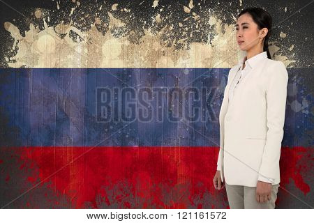 Smiling woman looking away against russia flag in grunge effect