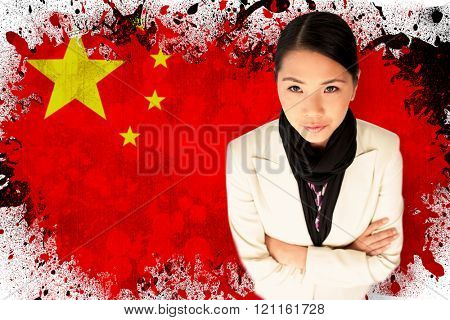 Businesswoman with arms folded against china