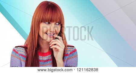 Portrait of a smiling hipster woman against blue vignette background