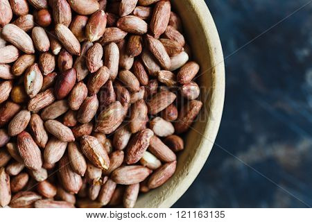 Roasted peanuts in wooden bowl