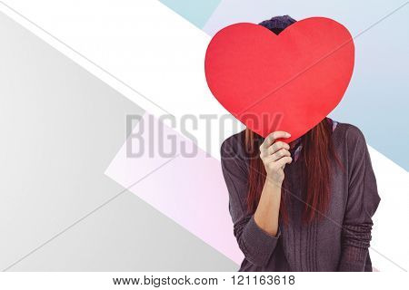 Hipster woman behind a red heart against colored background