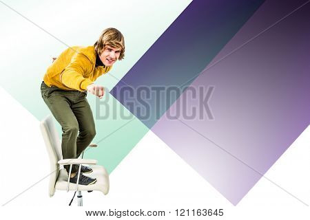 Happy hipster businessman standing on his chair against colored background
