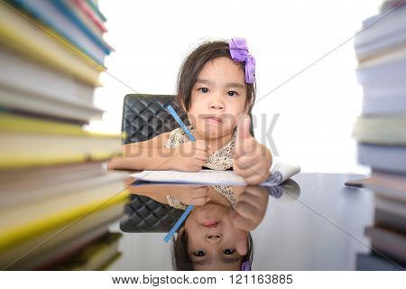 Happy Schoolgirl Works On Her Homework, Write Something In Her Notepad On White Background