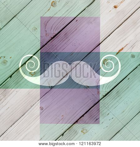 Mustache logo against colored wood