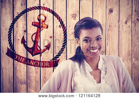 Smiling crestive business woman against wooden planks background