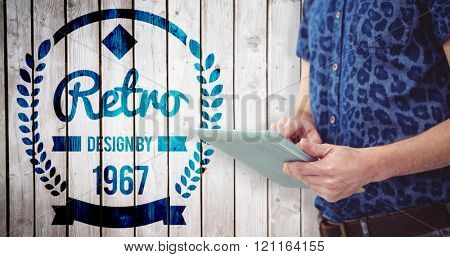 Handsome man with tablet against wooden planks