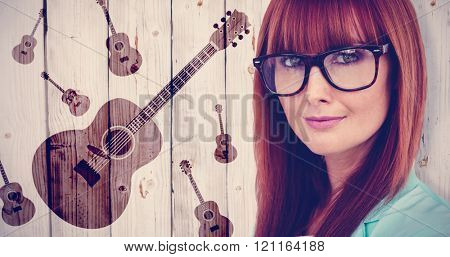 Portrait of a smiling hipster woman against wooden background
