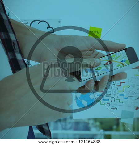 Cropped image of man using smartphone against adhesive notes on window